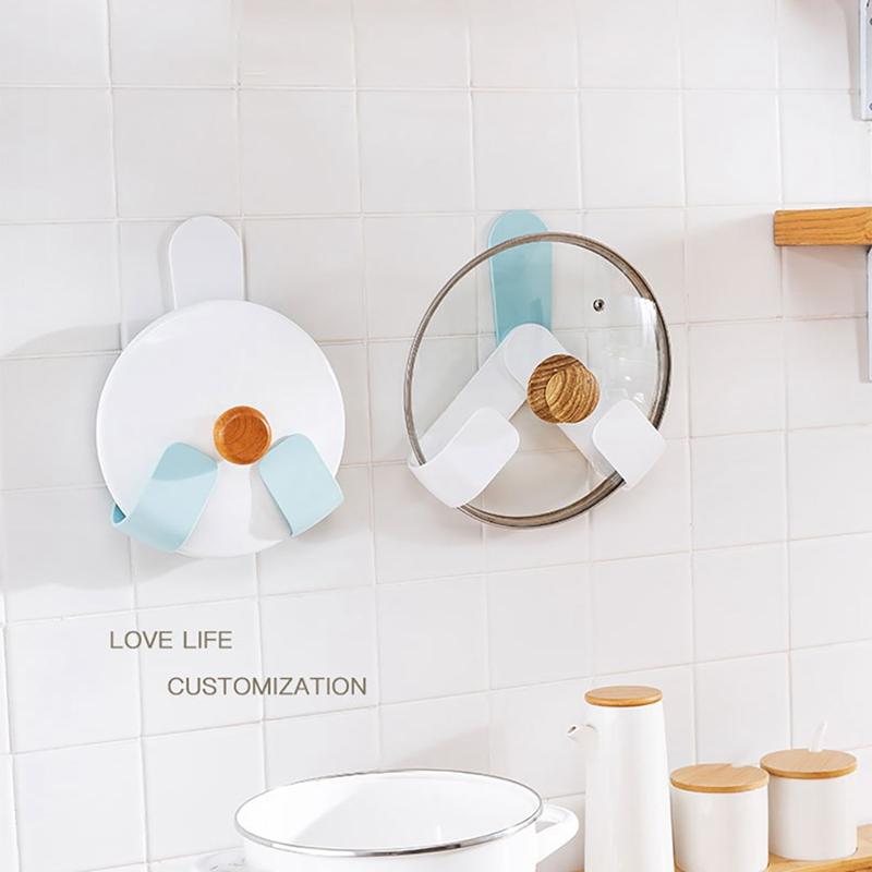 Kitchen-Rotatable-Pot-Storage-Rack-Folding-Wall-mounted-Storage-Sticky-Hangers thumbnail 3